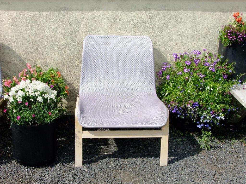 chair in between flowers